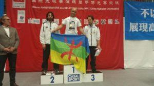 Amazigh Zenia raising Amazigh flag during podium ceremony ...